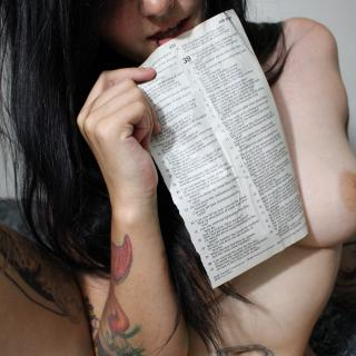 Rubbing Bible Page on My Pussy photo gallery by Espi Kvlt