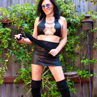 A Flogger, A Kinky Outfit And Boobs photo gallery by Jacquie Blu