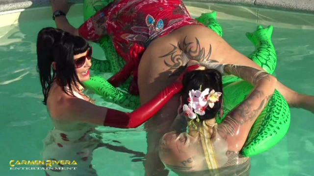 Carmen Rivera and Lady Vampira are celebrating a pool party with their slaves in the Femdom Empire 7 video from Ladyvampira