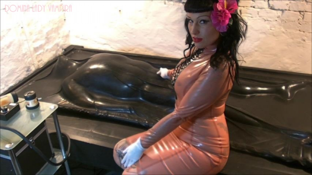 The Milkingmachine Footjob in the Latex VacBed video from Ladyvampira
