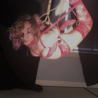 Floorwork and Suspension: red lingerie photo gallery by Lima Charlie